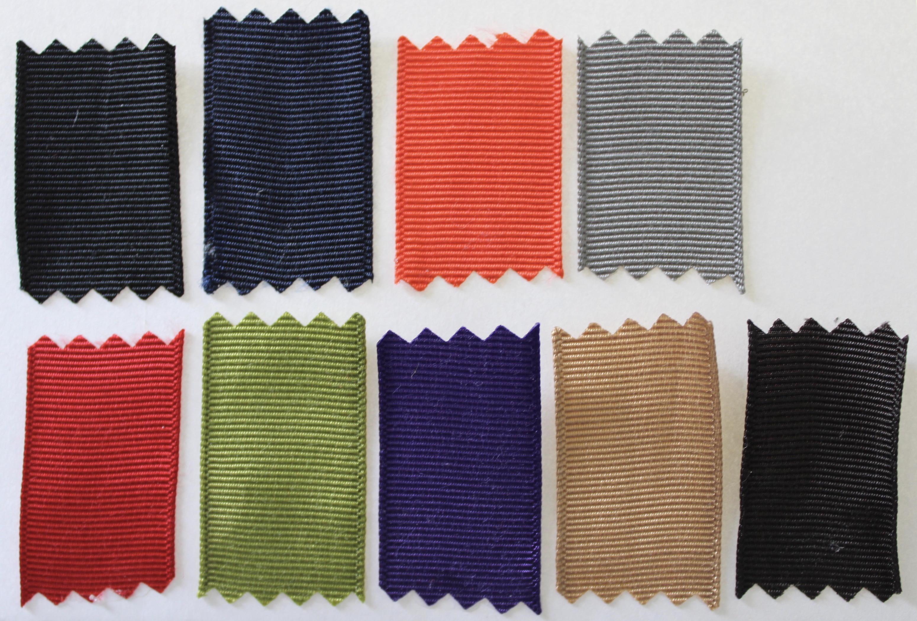 Ribbon Colours: black, navy blue, orange, light grey, red, grass green, purple, honey, black